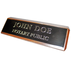 This elegant, genuine Illinois notary walnut desk, sign is made of solid wood and engraved on a metal plate with gold lettering with your notary name and the wording 'Notary Public'. It makes a fine addition to any desk or office. This sign can be customized with up to two lines.